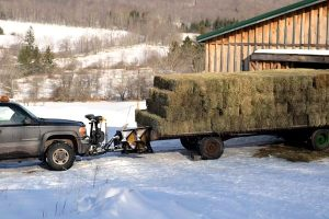Pushing the wagon into the barn makes unloading easier.